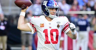 Eli Manning throws a pass during the first half against the Arizona Cardinals at University of Phoenix Stadium.