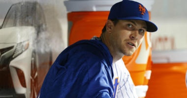 Jacob deGrom looks at the scoreboard from the dugout in the sixth inning against the Chicago Cubs at Citi Field.