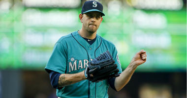 James Paxton reacts after getting a strikeout to end the first inning against the Boston Red Sox at Safeco Field.