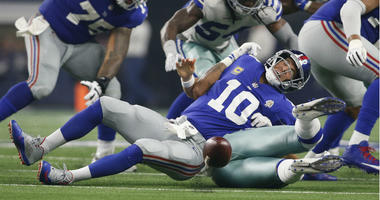 Damien Wilson causes a fumble on a sack of Eli Manning in the third quarter at AT&T Stadium.