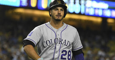 Nolan Arenado returns to the dugout after striking out with bases loaded in the first inning of the game against the Los Angeles Dodgers at Dodger Stadium.