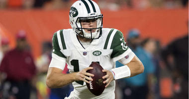 Sam Darnold rolls out to pass during the first quarter against the Cleveland Browns at FirstEnergy Stadium.