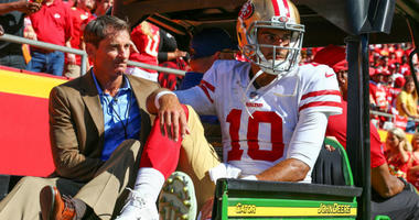 Jimmy Garoppolo is taken off the field after an injury in the second half against the Kansas City Chiefs at Arrowhead Stadium.