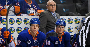 Barry Trotz looks on from behind the bench against the Washington Capitals during the third period at Barclays Center.