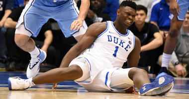 Zion Williamson reacts after falling during the first half against the North Carolina Tar Heels at Cameron Indoor Stadium.