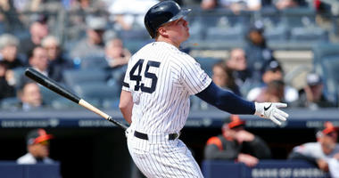 Luke Voit watches his three run home run against the Baltimore Orioles during the first inning at Yankee Stadium.