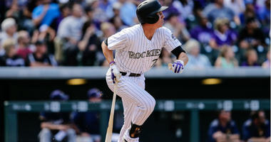 Jordan Patterson follows his ball on an RBI double in the fifth inning against the Milwaukee Brewers at Coors Field