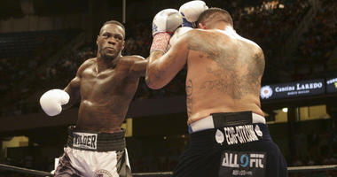 Deontay Wilder connects with a hit to Chris Arreola during their Premier Boxing Championships fight at Legacy Arena in Birmingham, Alabama, on July 16, 2016.