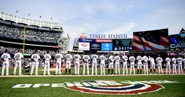 The New York Yankees stand for the national anthem before their game against the Baltimore Orioles on opening day at Yankee Stadium on March 28, 2019.
