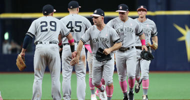 The Yankees celebrate a win in Tampa Bay