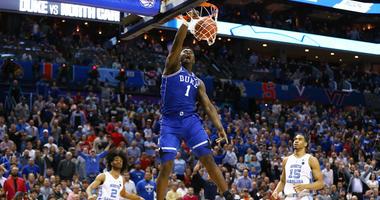 Duke forward Zion Williamson dunks against North Carolina on March 15, 2019, in the ACC tournament at the Spectrum Center in Charlotte, North Carolina.