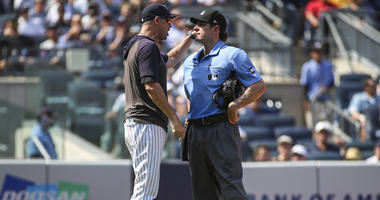 Yankees manager Aaron Boone argues with home plate umpire Ben May on Aug. 17, 2019, against the Cleveland Indians at Yankee Stadium.