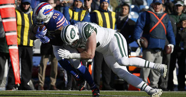 New York Jets defensive end Henry Anderson (96) tackles Buffalo Bills running back Marcus Murphy (45) as he runs the ball during the first half at New Era Field.