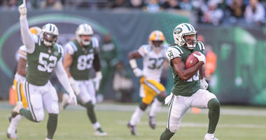 The Jets' Andre Roberts scores touchdown on a kickoff return against the Green Bay Packers on Dec. 23, 2018, at MetLife Stadium.