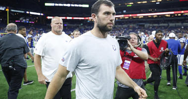 Andrew Luck walks off the field after the game against the Chicago Bears at Lucas Oil Stadium on Aug. 24, 2019.