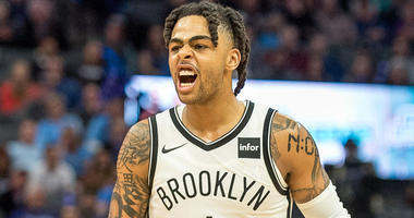 Nets guard D'Angelo Russell celebrates after making a fourth-quarter shot against the Kings on March 19, 2019, at the Golden 1 Center in Sacramento, California.