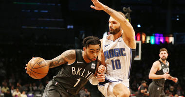 Nets guard D'Angelo Russell dribbles the ball against Magic guard Evan Fournier on Jan. 23, 2019, at Barclays Center.
