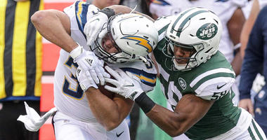Chargers tight end Sean McGrath is tackled by Jets linebacker Darron Lee during on Dec. 24, 2017, at MetLife Stadium.