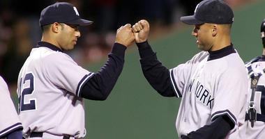Derek Jeter and Mariano Rivera celebrate a win in Boston on April 13, 2005.