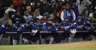 The Los Angeles Dodgers watch the ninth inning of Game 2 of the World Series from their dugout against the Boston Red Sox on Wednesday at Fenway Park in Boston.