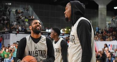 Kevin Durant and Kyrie Irving talk at the 2018 NBA All-Star Game.