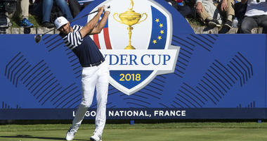 Dustin Johnson tees off on the 17th hole during a Ryder Cup practice round on Sept. 27, 2018, at Le Golf National in Saint-Quentin-en-Yvelines, France.