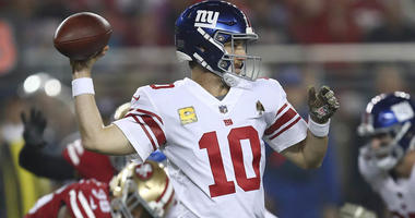 New York Giants quarterback Eli Manning (10) passes against the San Francisco 49ers during the first half of an NFL football game in Santa Clara, Calif., Nov. 12, 2018.