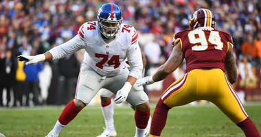 Giants offensive tackle Ereck Flowers (74) prepares to block Washington Redskins linebacker Preston Smith (94) during the first half at FedEx Field.