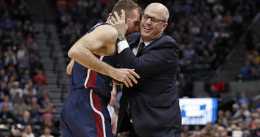 Fairleigh Dickinson coach Greg Herenda embraces Nadi Beciri after a basket against Gonzaga during the second half in the first round of the NCAA tournament on March 21, 2019, in Salt Lake City, Utah.