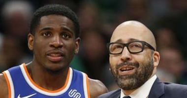 Knicks coach David Fizdale talks with guard Damyean Dotson during a game at Boston on Dec. 6, 2018.