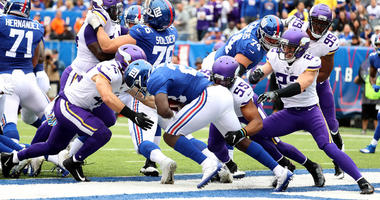 Jon Hilliman of the Giants is tackled by Anthony Barr of the Minnesota Vikings in the end zone for a safety on Oct. 6, 2019, at MetLife Stadium.