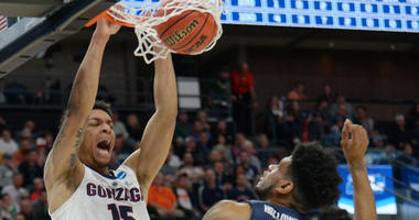 Gonzaga forward Brandon Clarke dunks over Fairleigh Dickinson forward Mike Holloway Jr. during their NCAA Tournament game on March 21, 2019, in Salt Lake City, Utah.