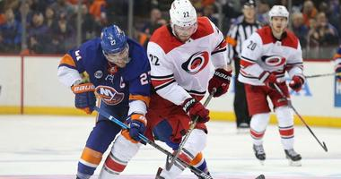 The Islanders' Anders Lee and the Hurricanes' Brett Pesce fight for the puck during the third period of Game 2 of their second-round playoff series on April 28, 2019, at the Barclays Center.