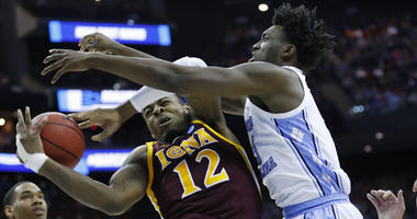 North Carolina Tar Heels forward Nassir Little (5) knocks the ball away from Iona Gaels forward Tajuan Agee (12) in the first half in the first round of the NCAA Tournament on March 22, 2019, in Columbus, Ohio.