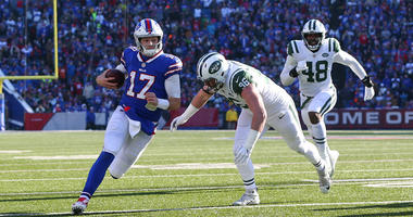 Bills quarterback Josh Allen runs with the ball as Jets defensive end Henry Anderson defends on Dec. 9, 2018, at New Era Field in Orchard Park, New York.