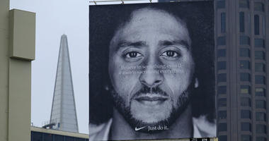 A large billboard stands on top of a Nike store showing former San Francisco 49ers quarterback Colin Kaepernick at Union Square in San Francisco.