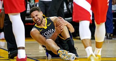 Golden State Warriors guard Klay Thompson reacts after an injury against the Toronto Raptors in gGame 6 of the NBA Finals on June 13, 2019, at Oracle Arena in Oakland, California.