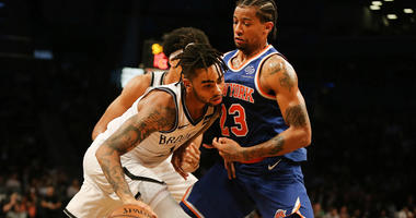 Nets guard D'Angelo Russell dribbles the ball while being defended by Knicks guard Trey Burke on Oct. 3, 2018, at Barclays Center.