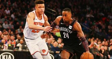 Nets forward Rondae Hollis-Jefferson dribbles the ball against Knicks forward Kevin Knox on Dec. 8, 2018, at Madison Square Garden.