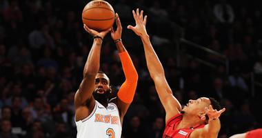 Knicks guard Tim Hardaway Jr. shoots against Portland Trail Blazers guard CJ McCollum on Nov. 20, 2018, at Madison Square Garden.
