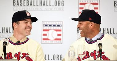 Former Yankees pitchers Mike Mussina (left) and Mariano Rivera (right) laugh during a Hall of Fame news conference on Jan. 23, 2019, in New York.