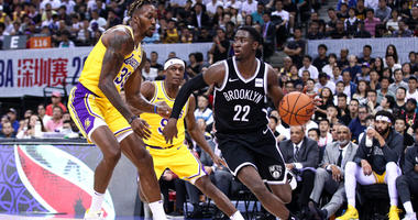 The Nets' Caris LeVert in action during the match against the Lakers' Rajon Rondo and Dwight Howard during a preseason game on Oct.12, 2019 in Shenzhen, China.