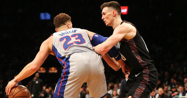 Pistons forward Blake Griffin dribbles the ball against Nets forward Rodions Kurucs on March 11, 2019, at Barclays Center.