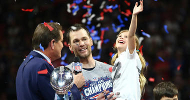 Patriots quarterback Tom Brady and daughter Vivian celebrate as they are interviewed by CBS host Jim Nantz after Super Bowl LIII against the Los Angeles Rams on Feb. 3, 2019, at Mercedes-Benz Stadium in Atlanta.