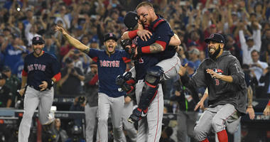 Red Sox pitcher Chris Sale (left) celebrates with teammates including catcher Christian Vazquez and pitcher David Price (right) after defeating the Los Angeles Dodgers in Game 5 of the World Series on Oct. 28, 2018, at Dodger Stadium in Los Angeles.