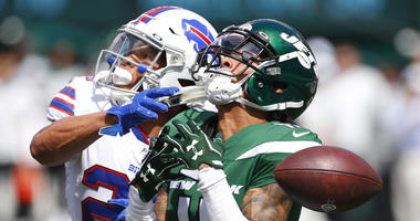 Jets wide receiver Robby Anderson drops a pass against Bills cornerback Taron Johnson on Sept. 8, 2019, at MetLife Stadium.