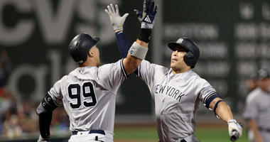 Yankees right fielder Aaron Judge (99) celebrates with left fielder Giancarlo Stanton on Oct. 6, 2018, after hitting a solo home run against the Boston Red Sox in Game 2 of their ALDS playoff baseball series at Fenway Park in Boston.