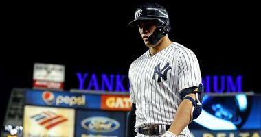 Yankees designated hitter Giancarlo Stanton reacts during the sixth inning against the Boston Red Sox in Game 4 of their ALDS on Oct. 9, 2018, at Yankee Stadium.