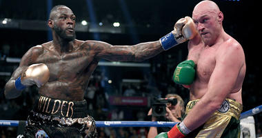 Deontay Wilder punches Tyson Fury in the ninth round fighting to a draw during the WBC heavyweight championship at Staples Center on Dec. 1, 2018 in Los Angeles, California.