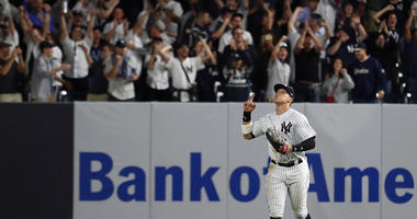 Aaron Judge #99 of the New York Yankees celebrates after defeating the Oakland Athletics by a score of 7-2 to win the American League Wild Card Game at Yankee Stadium on October 03, 2018.